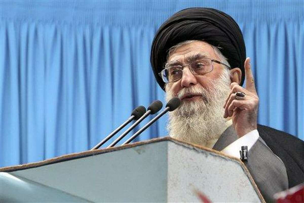 In this photo released by an official website of the Iranian supreme leader's office, Iranian supreme leader Ayatollah Ali Khamenei, delivers Friday prayers sermon, at the Tehran University campus, Iran, Friday, Feb. 3, 2012. Iran will help any nation or group that confronts the