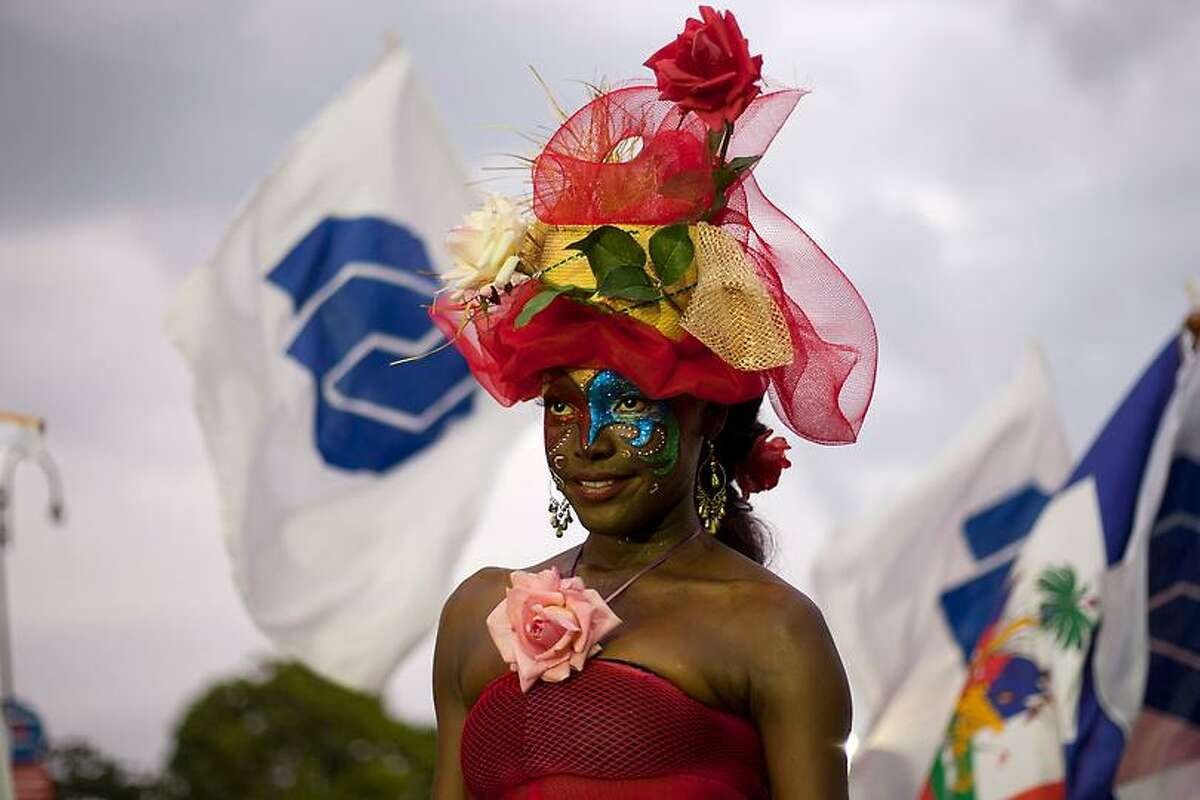 A woman parades during carnival of flowers in Port-au-Prince, Haiti, Monday July 30, 2012. The carnival, a three-day festival, marks new beginnings and the revitalization of Haiti with a Sunday parade, concerts and street dancing. Some critics have questioned the wisdom of spending about $1.6 million on the event. The government countered saying the celebration boosts morale and provides jobs. (AP Photo/Dieu Nalio Chery)