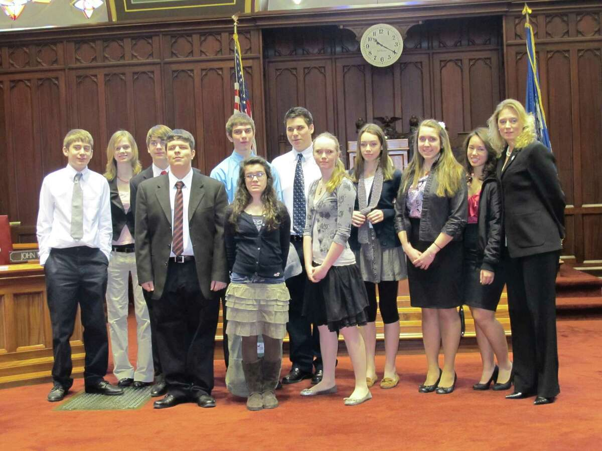 Submitted photo State Rep. Michelle Cook recently hosted the THS Young Democrats Club at the state capitol, to hear Gov. Malloy's budget address, Wednesday, in a joint session of the General Assembly.