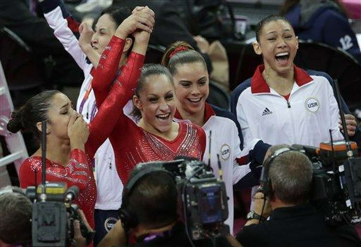 U.S. gymnasts, from left to right, Alexandra Raisman, Jordyn Wieber, McKayla Maroney and Kyla Ross celebrate after being declared winners of the gold medal during the Artistic Gymnastic women's team final Tuesday at the 2012 Summer Olympics in London. Associated Press
