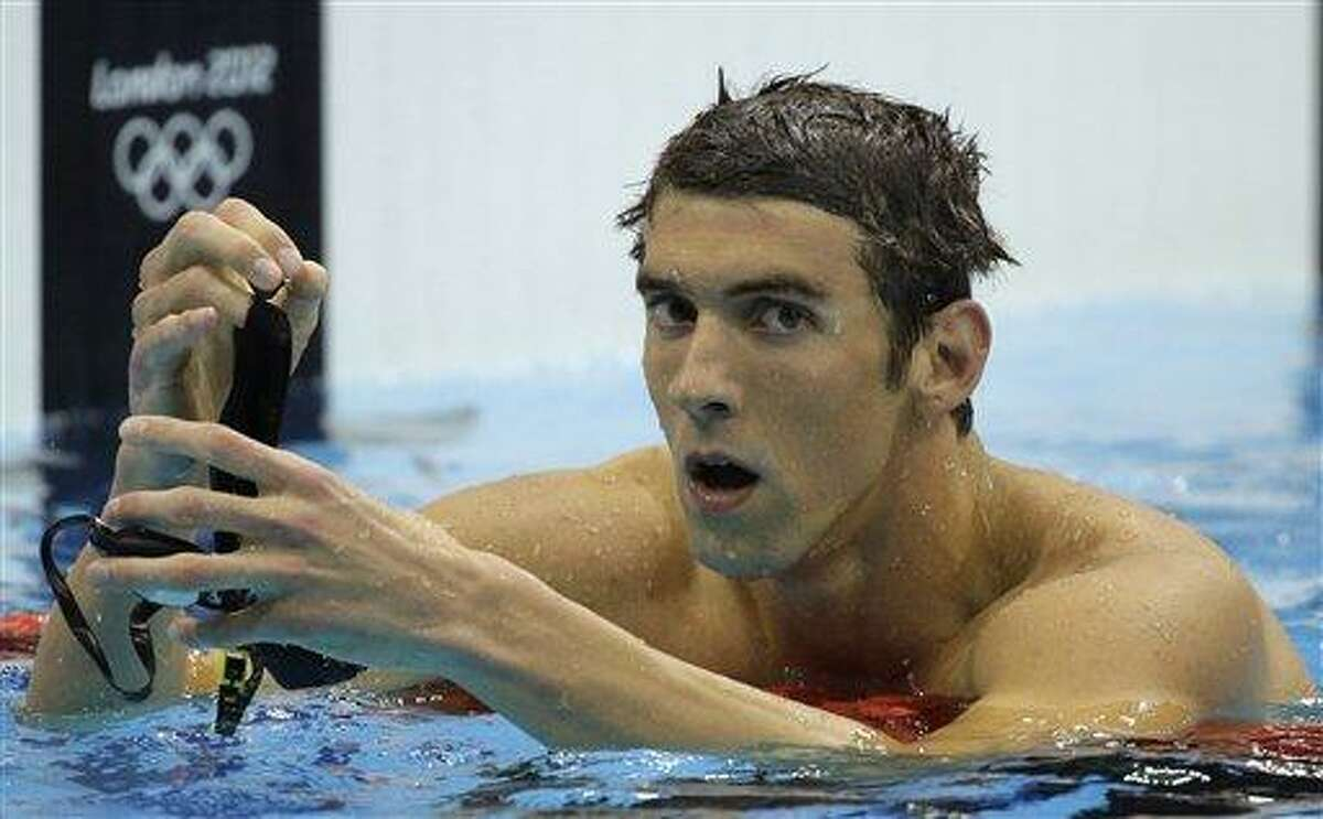 United States' Michael Phelps reacts after winning silver in the men's 200-meter butterfly swimming final at the Aquatics Centre in the Olympic Park during the 2012 Summer Olympics in London, Tuesday, July 31, 2012. (AP Photo/Matt Slocum)