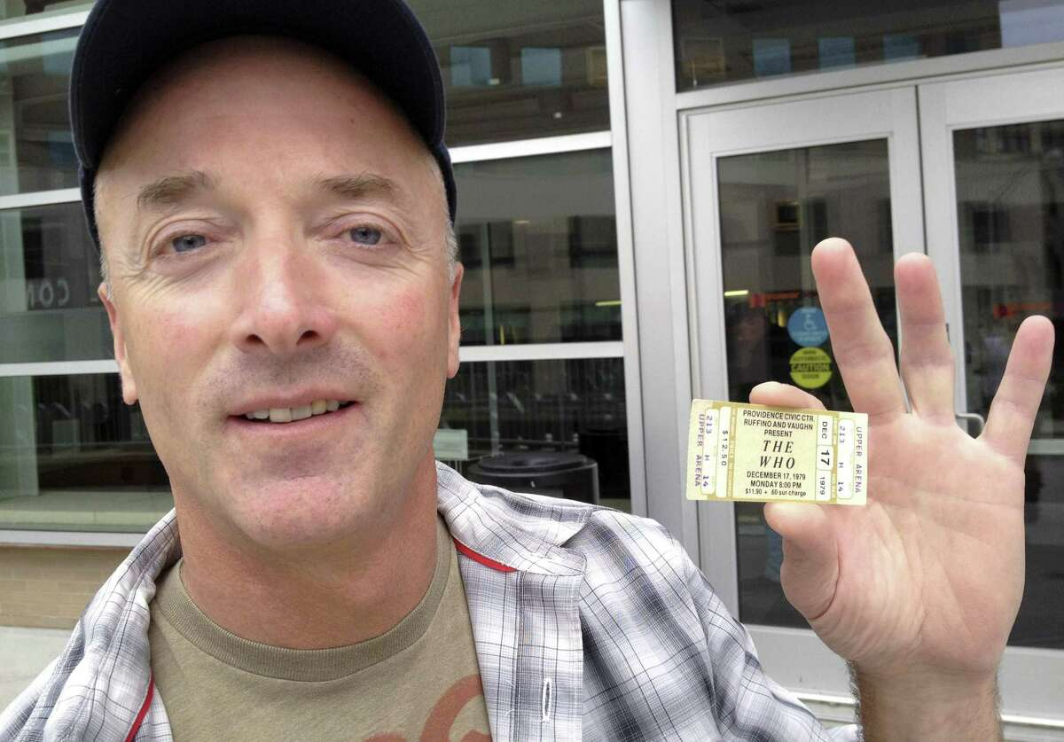 Emery Lucier, 50, of Milford, Mass., holds a ticket for a canceled-1979 concert by The Who outside the Dunkin Donuts Center in Providence, R.I., Tuesday, July 31, 2012. Lucier was among fans who redeemed tickets from a canceled 1979 show, for The Who's Quadrophenia show set to play there in February 2013. Their 1979 concert was cancelled due to safety concerns after 11 people died in a stampede before a show in Ohio. (AP Photo/Michelle R. Smith)