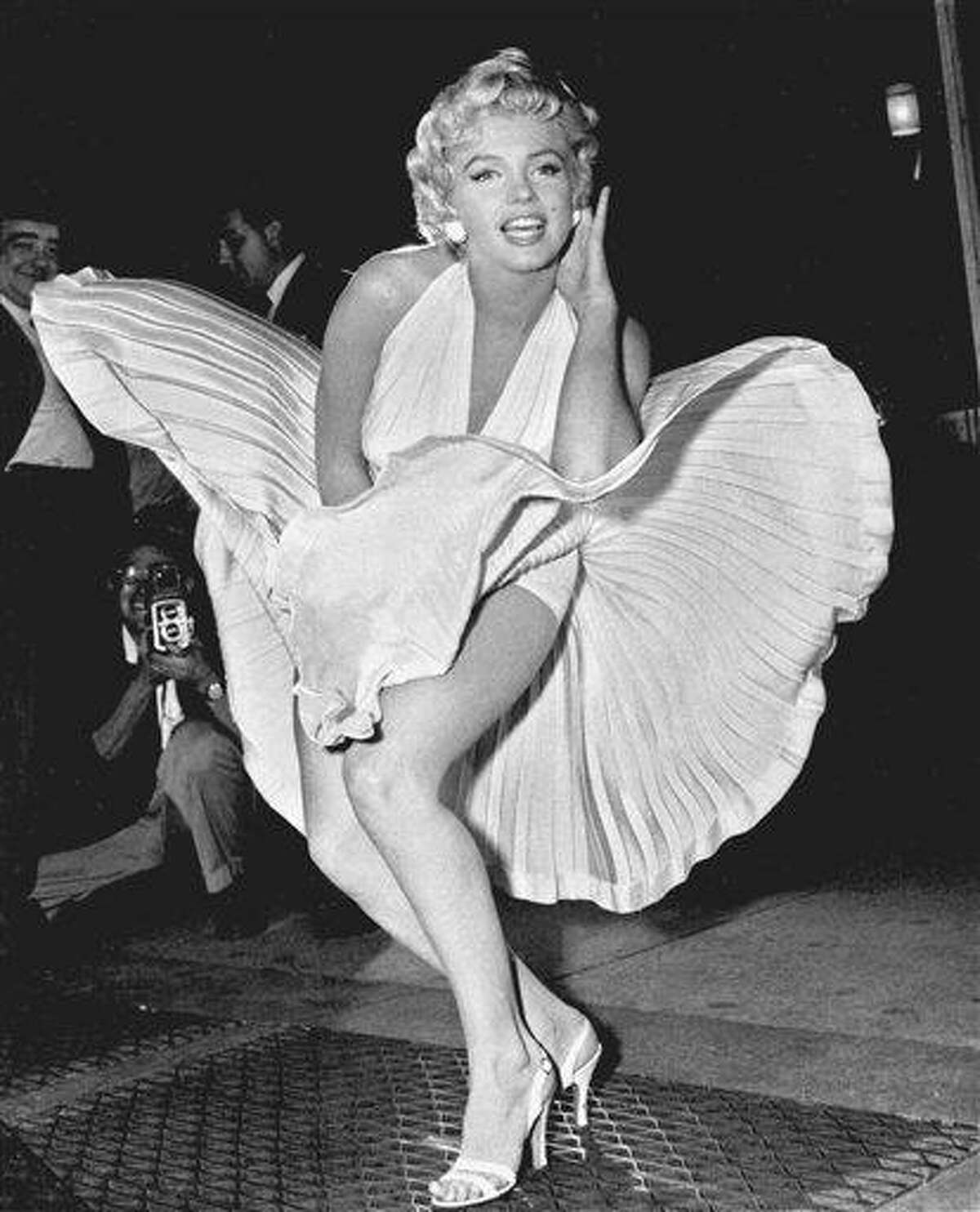 FILE - In this Sept. 9, 1954 file photo, Marilyn Monroe poses over the updraft of New York subway grating while in character for the filming of