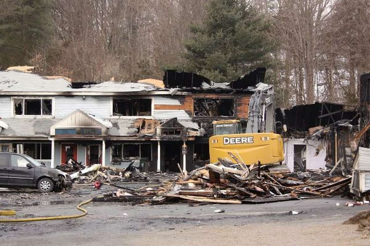 A partially collapsed building destroyed by an early morning fire in Southbury; photo by Walter Kidd.