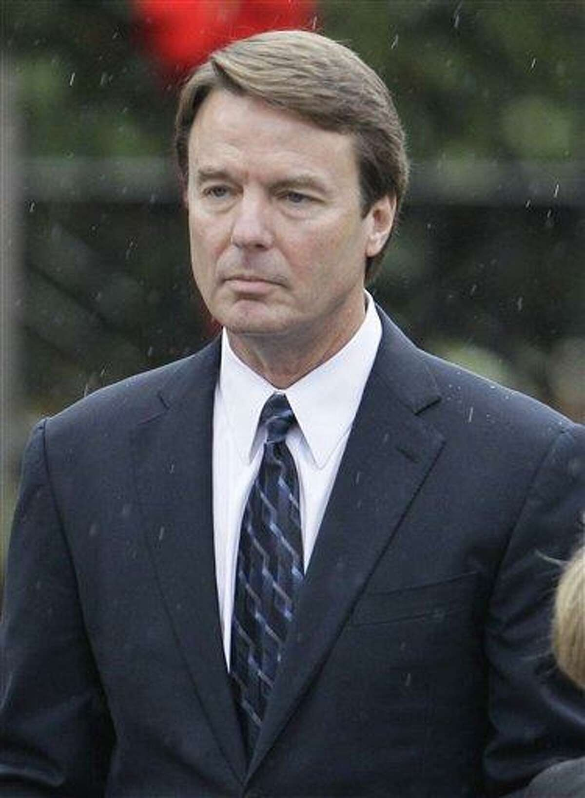 FILE - In this Dec. 11, 2010 file photo, former Democratic presidential candidate John Edwards is seen in Raleigh, N.C. Edwards and federal prosecutors are arguing over whether the money used to cover up his extramarital affair was a campaign contribution or just a gift from his old friends. An indictment of the 2004 Democratic vice presidential nominee appears imminent, but people on both sides still hold out hope for a last-minute deal for a guilty plea to a negotiated charge. (AP Photo/Gerry Broome, File)
