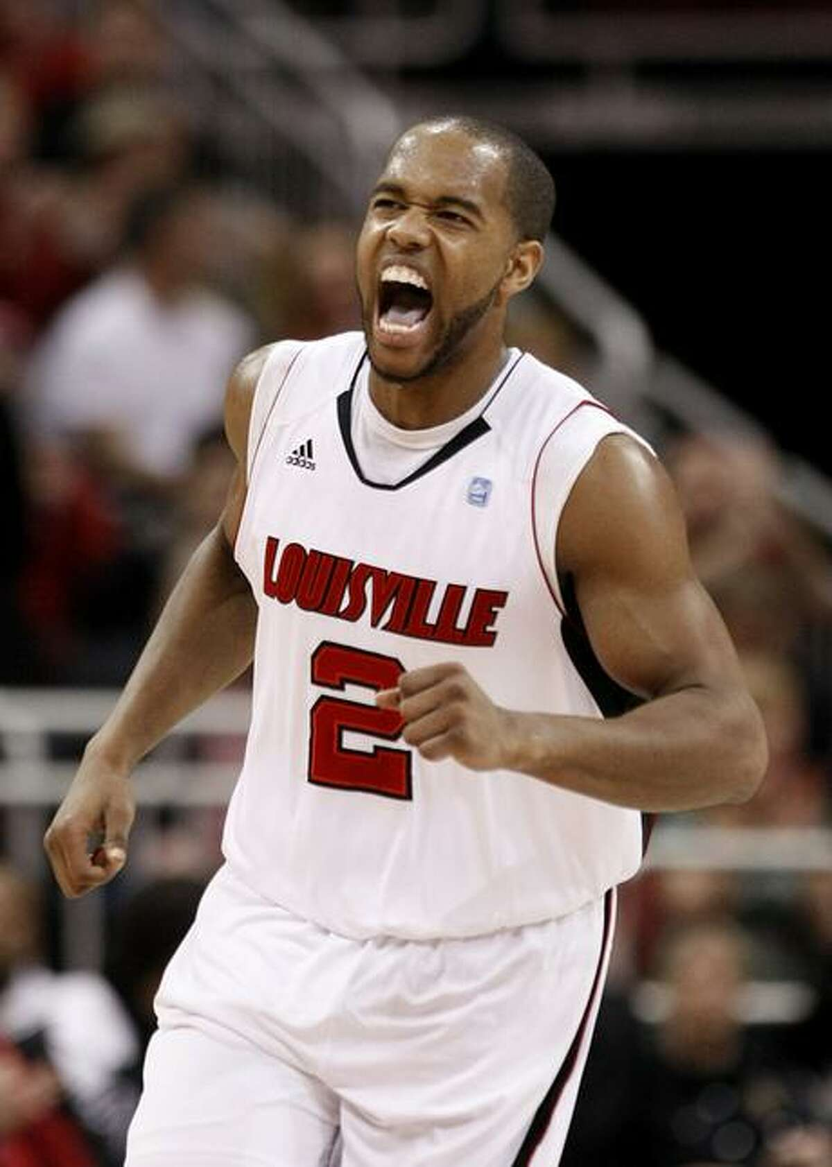Louisville's Preston Knowles yells out after hitting a shot during the first half of an NCAA college basketball game against Connecticut, in Louisville, Ky., Friday, Feb. 18, 2011. (AP Photo/Ed Reinke)