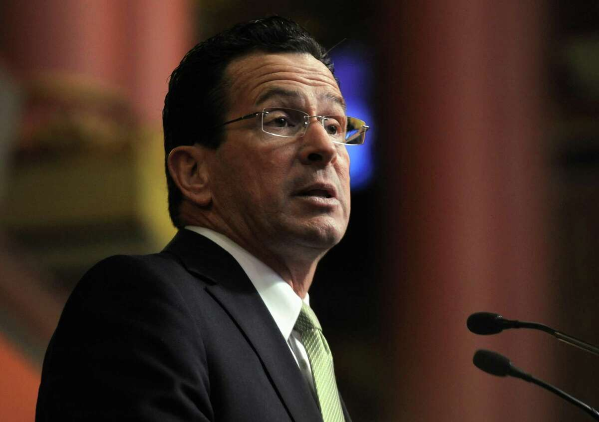 Connecticut Gov. Dannel P. Malloy presents his first two-year budget, during a joint session of the General Assembly at the Capitol, in Hartford, Conn., Wednesday, Feb. 16, 2011. The plan raises taxes across-the-board, seeks $2 billion in savings from state employees and attempts to cut spending without stripping programs for the needy. (AP Photo/Jessica Hill)