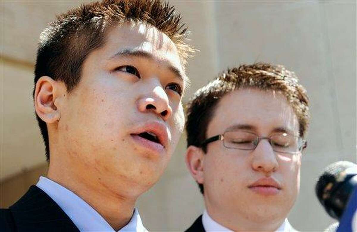 Chris Le, brother of Annie Le, left, speaks to the media as fiancee Jonathan Widawsky, right listens outside Superior Court in New Haven, Conn., Friday, June 3, 2011. Raymond Clark III was sentence to 44 years for the murder and attempted sexual assault in the strangling of 24-year-old Yale University graduate student Annie Le of Placerville, Calif. Her body was found stuffed behind a research lab wall on the day she was supposed to get married. (AP Photo/Jessica Hill)