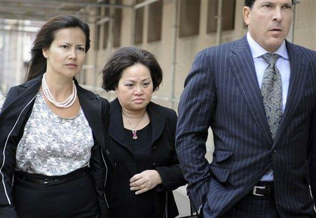 Vivian Van Le, mother of Annie Le, center walks with Joseph Tacopina, attorney for the Le family, right, and an unidentified woman, left, outside Superior Court in New Haven, Conn., Friday, June 3, 2011. Raymond Clark III is being sentenced in the murder and attempted sexual assault in the strangling of 24-year-old Yale University graduate student Annie Le of Placerville, Calif. Le's body was found behind a lab wall on Sept. 13, 2009, five days after she was last seen inside the medical building. It would have been her wedding day. (AP Photo/Jessica Hill)