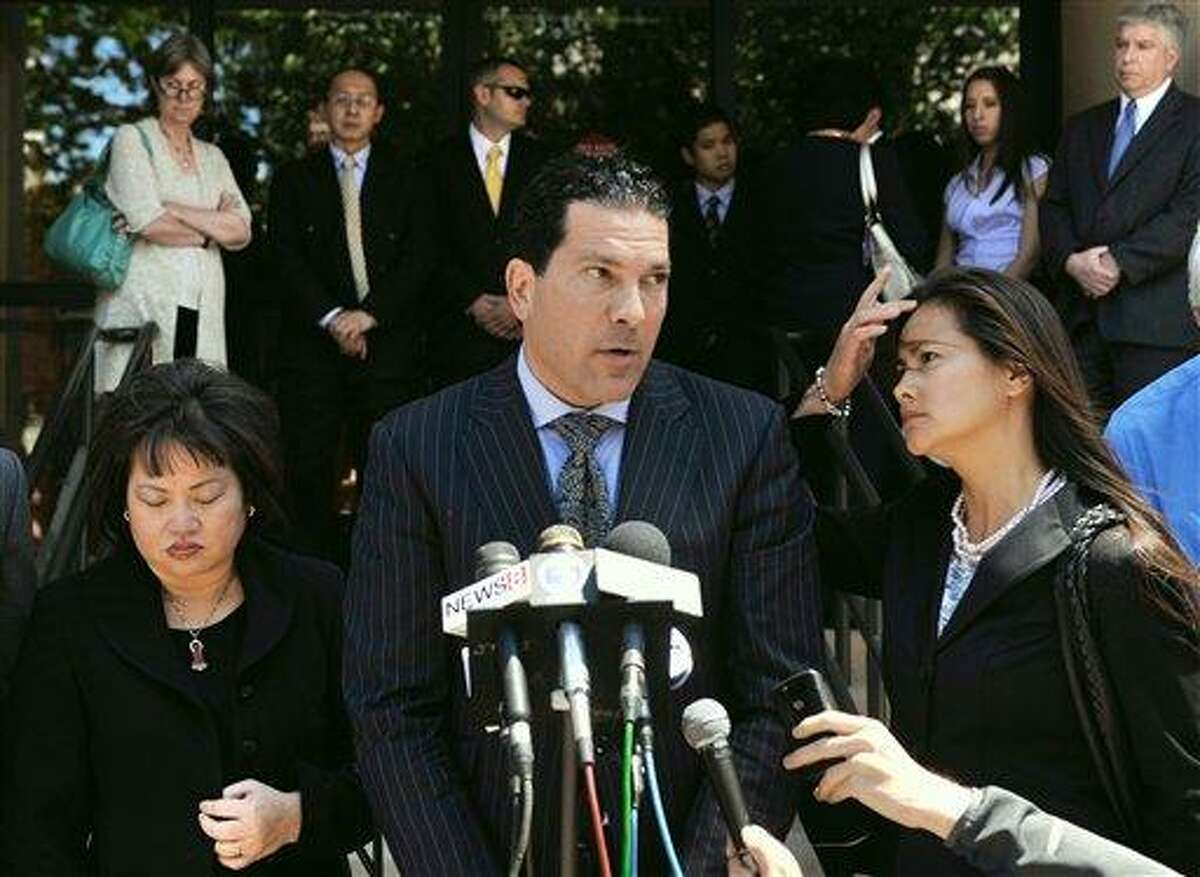 Joseph Tacopina, attorney for the Le family, center, speaks to the media as Vivian Van Le, mother of Annie Le, left, and family friend Mary Nguyen, right, listens outside Superior Court in New Haven, Conn., Friday, June 3, 2011. Raymond Clark III was sentenced to 44 years in the murder and attempted sexual assault in the strangling of 24-year-old Yale University graduate student Annie Le of Placerville, Calif. Le's body was found behind a lab wall on Sept. 13, 2009, five days after she was last seen inside the medical building. It would have been her wedding day. (AP Photo/Jessica Hill)