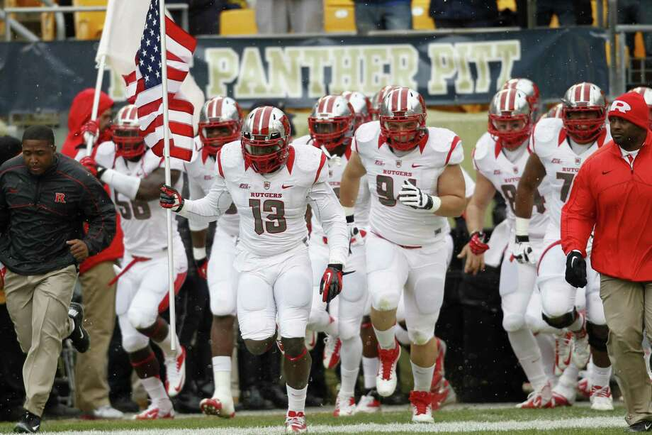 Rutgers rushes out of the locker room before their game against Pittsburgh. By The Associated Press Photo: ASSOCIATED PRESS / AP2012