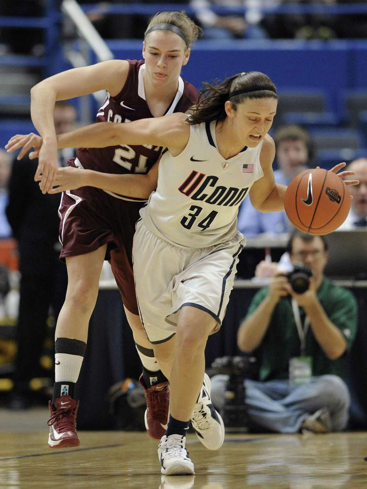 Connecticut's Kelly Faris, right, intercepts a pass intended for Colgate's Missy Repoli, left, during the first half of a NCAA college basketball game in Hartford, Conn., Wednesday, Nov. 28, 2012. (AP Photo/Jessica Hill)