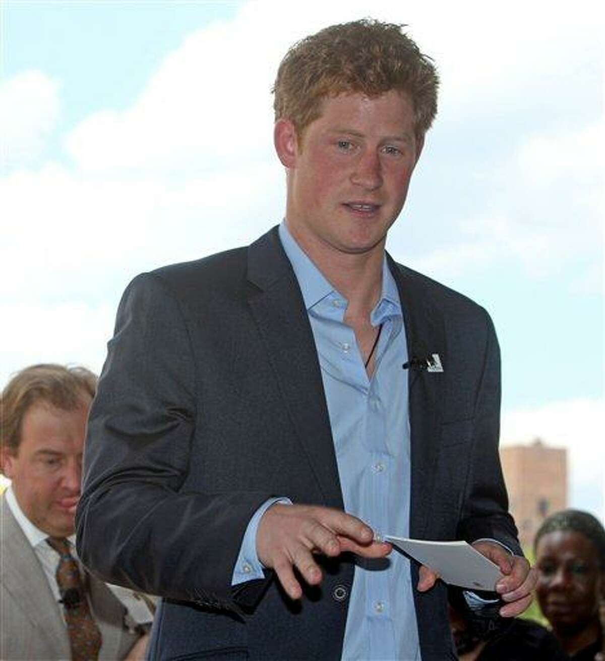 In this file photo taken Saturday May 30, 2009, Britain's Prince Harry addresses guests at the second annual Veuve Clicquot Manhattan Polo Classic polo match on Governor's Island in New York. The Prince sipped a Corona during a Cirque du Soleil show in Las Vegas over the Nov. 19-20 trip and rented a Harley. The British royal made a low-key appearance at a Scottsdale, Ariz., dealership on Friday. The vacation came as the prince is training on helicopters at an Air Force site near Gila Bend, Ariz. (AP)