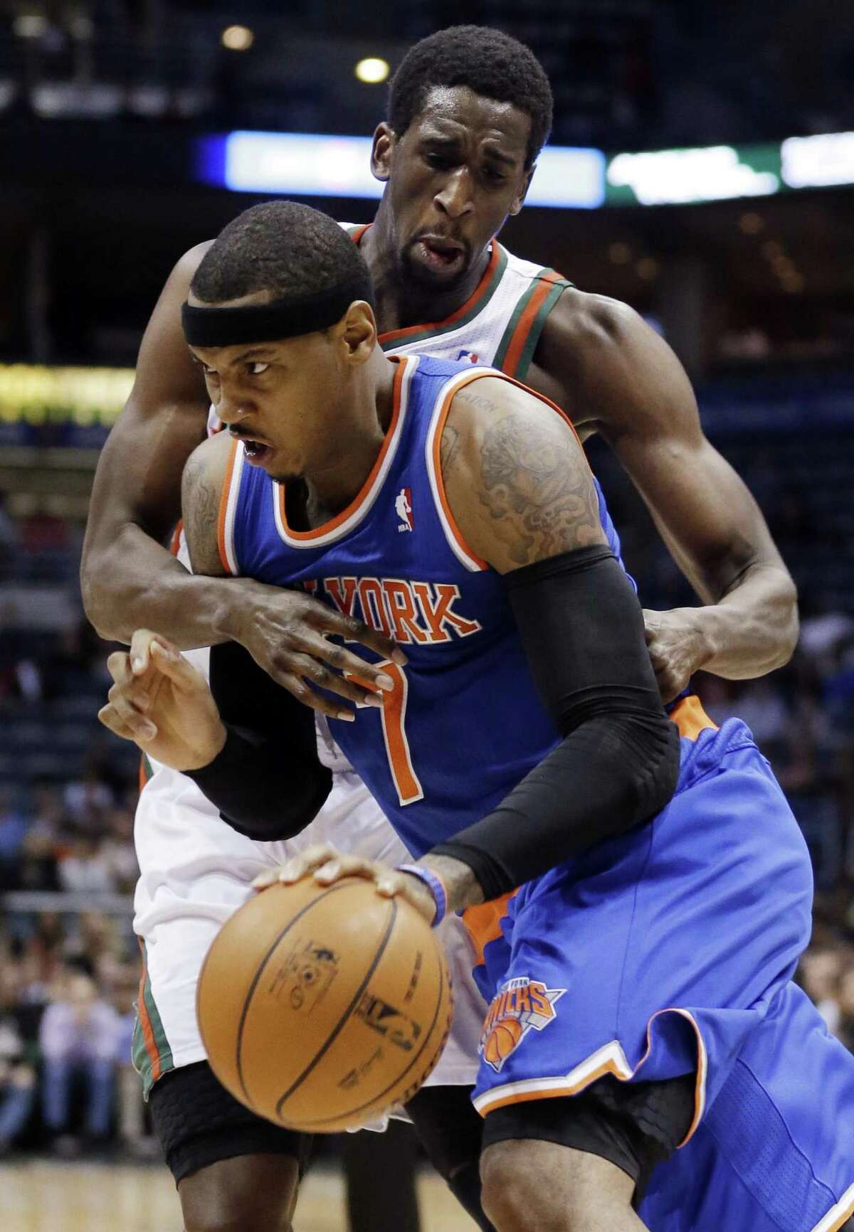 New York Knicks' Carmelo Anthony is fouled by Milwaukee Bucks' Ekpe Udoh as he drives during the first half of an NBA basketball game Wednesday, Nov. 28, 2012, in Milwaukee. (AP Photo/Morry Gash)