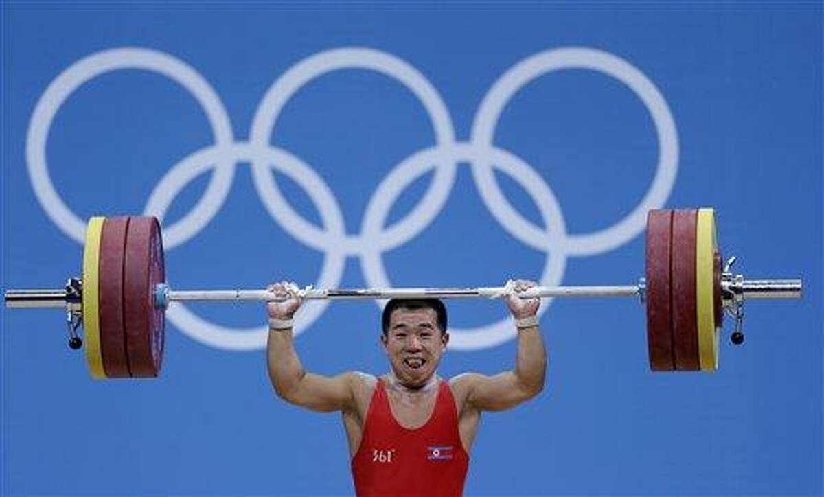 North Korea's Om Yun Chol lifts during the men's 56-kg, group B, weightlifting competition at the 2012 Summer Olympics, Sunday, July 29, 2012, in London. Om joined an exclusive group of weightlifters who have lifted three times their body weight. Om, who stands just 1.52 meters tall, also set an Olympic record when he cleared 168 kilograms in the clean and jerk in the men's 56-kilogram category. (AP Photo/Hassan Ammar)