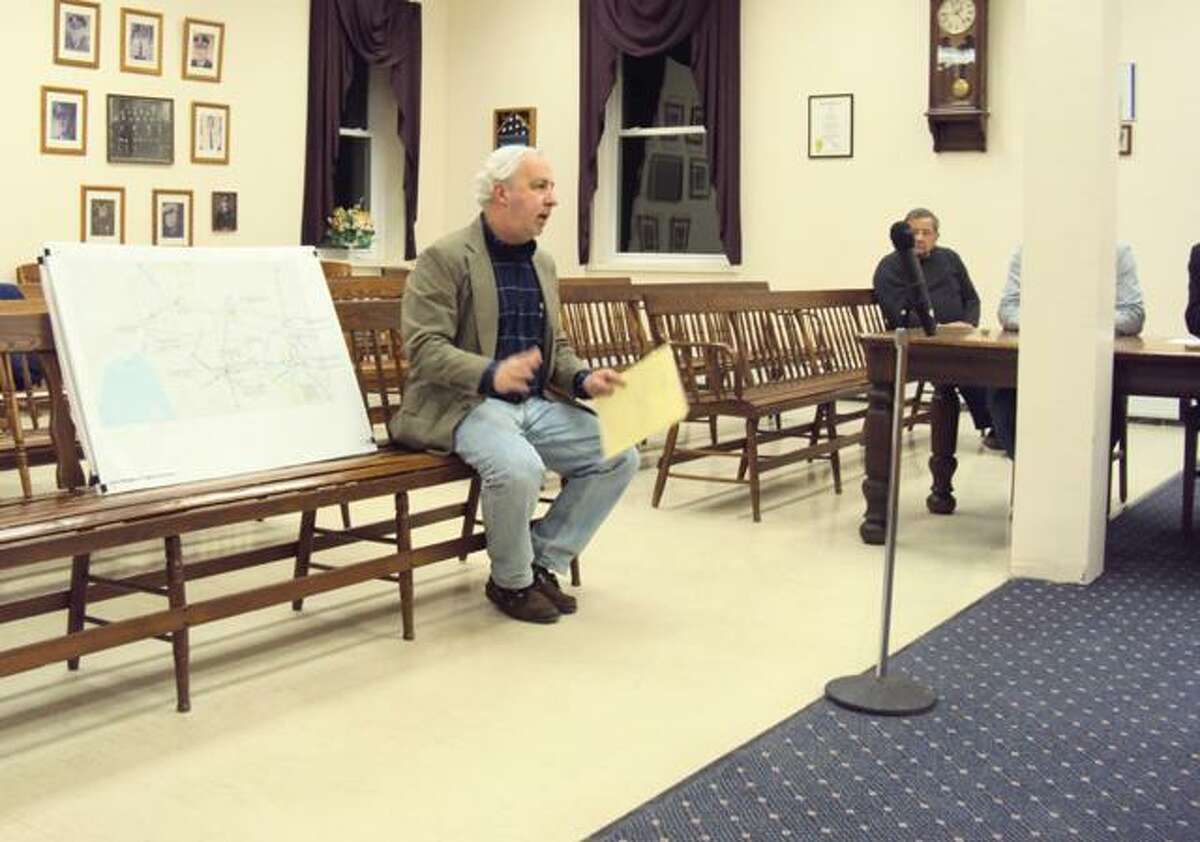 RICKY CAMPBELL/ Register CitizenProfessor of architecture and urbanism at the Yale School of Architecture and founder of Yale Urban Design Workshop Alan Plattus deliberates the Winchester Economic Development Commission on past projects in downtown Winsted.