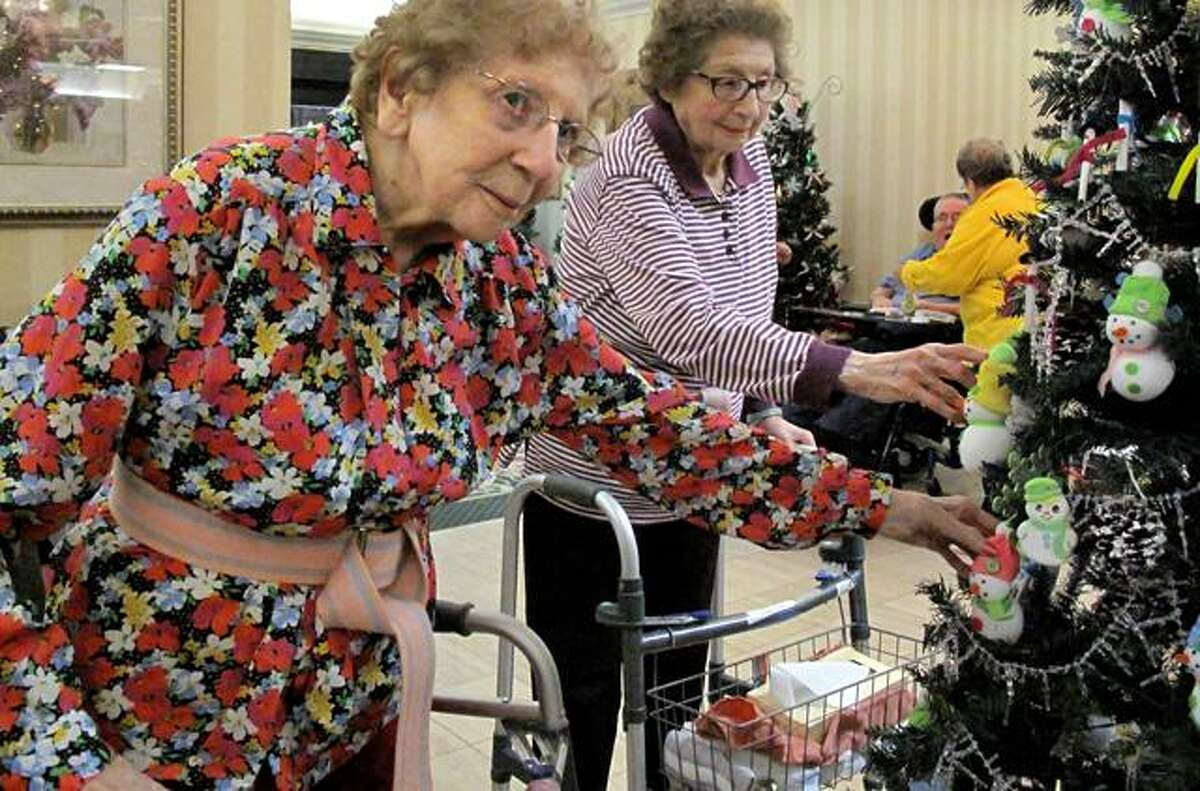 Sisters Marie Forrest and Bernice Rubino have been roommates at Valerie Manor for the last few years. They are enjoying the ornaments they made with other residents for their special Christmas tree this year.