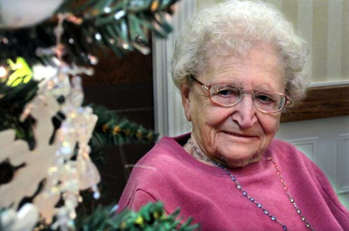 Marge Rosati, 89, admires the hand crafted ornaments she and the other residents of Valerie Manor made for their special Christmas tree.