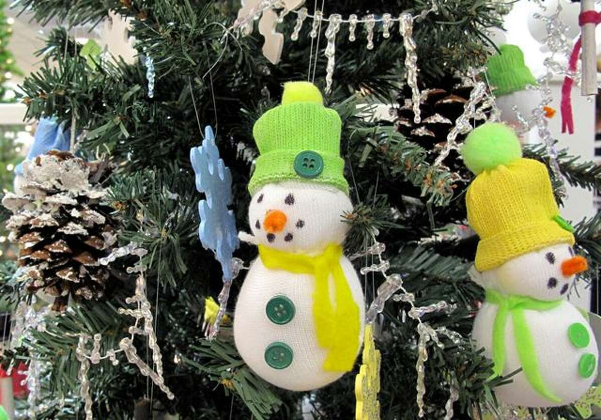 Ornaments hang on the resident's Christmas tree in the lobby of Valerie Manor. The residents handcrafted the ornaments this year.