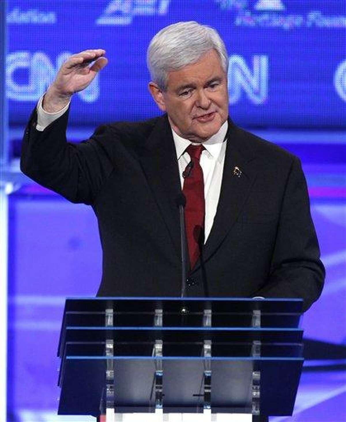 Republican presidential candidate former House Speaker Newt Gingrich speaks at a Republican presidential debate in Washington, Tuesday, Nov. 22, 2011. (AP Photo/Evan Vucci)
