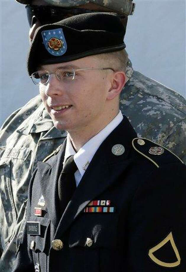 FILE - In this June 25, 2012, file photo, Army Pfc. Bradley Manning is escorted out of a courthouse in Fort Meade, Md., after a pretrial hearing. Manning, the U.S. Army private charged with sending reams of government secrets to WikiLeaks, is expected to testify during a pretrial hearing starting Tuesday, Nov. 27, 2012, at Fort Meade. Manning is seeking dismissal of all charges. He claims his solitary confinement, sometimes with no clothing, was illegal punishment. (AP Photo/Patrick Semansky, File) Photo: AP / AP