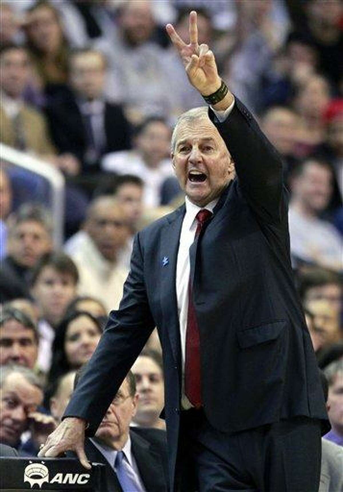 Connecticut head coach Jim Calhoun directs his team during the second half of an NCAA college basketball game against Georgetown, Wednesday, Feb. 1, 2012, in Washington. Georgetown won 58-44. (AP Photo/Haraz Ghanbari)