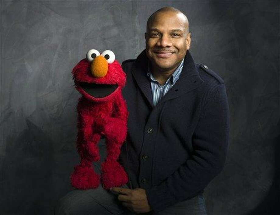 """Elmo puppeteer Kevin Clash poses with the """"Sesame Street"""" muppet in the Fender Music Lodge during the 2011 Sundance Film Festival in Park City, Utah. Associated Press file photo Photo: ASSOCIATED PRESS / A2011"""