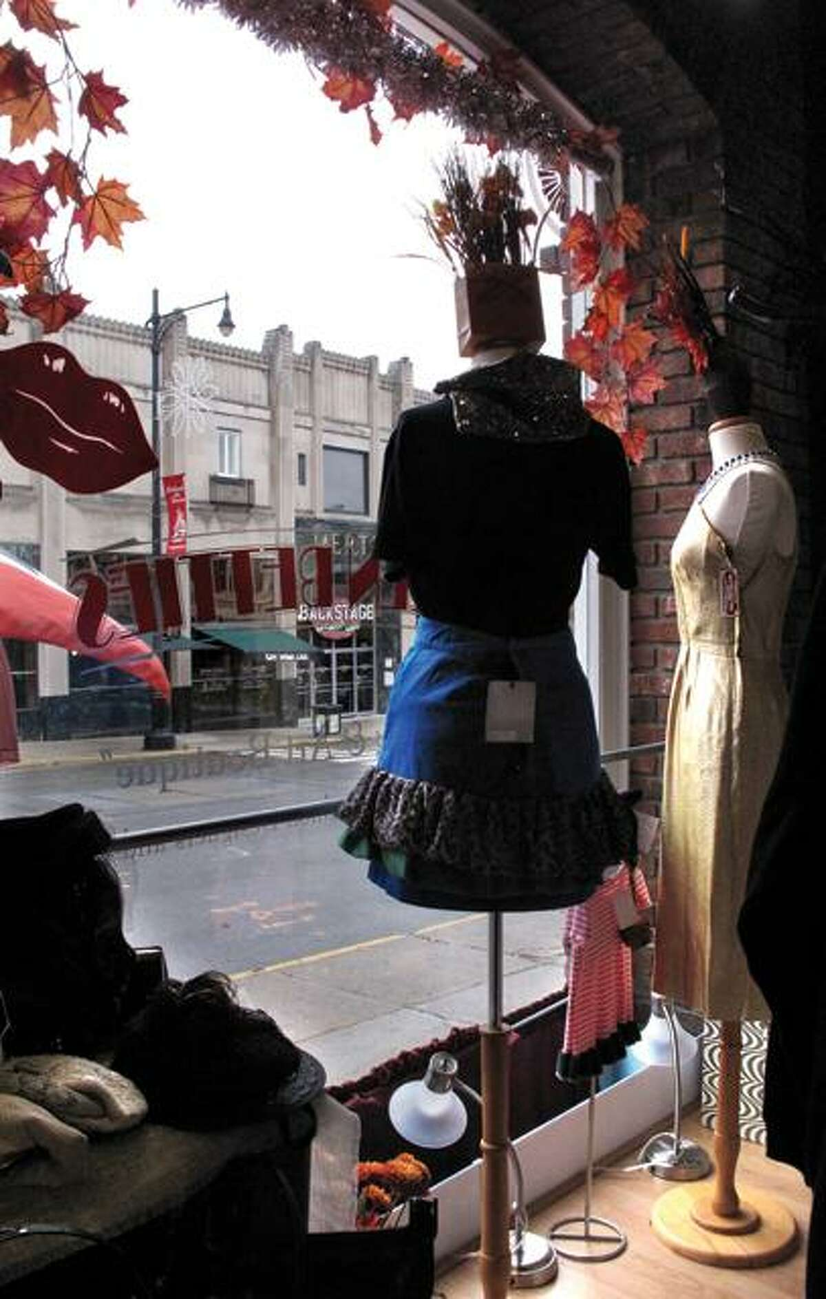 DEBBI MORELLO / Register Citizen Brazen Betties' showcase window is decorated in anticipation of Small Business Saturday this weekend. The day is set aside to recognize and support locally-owned businesses.