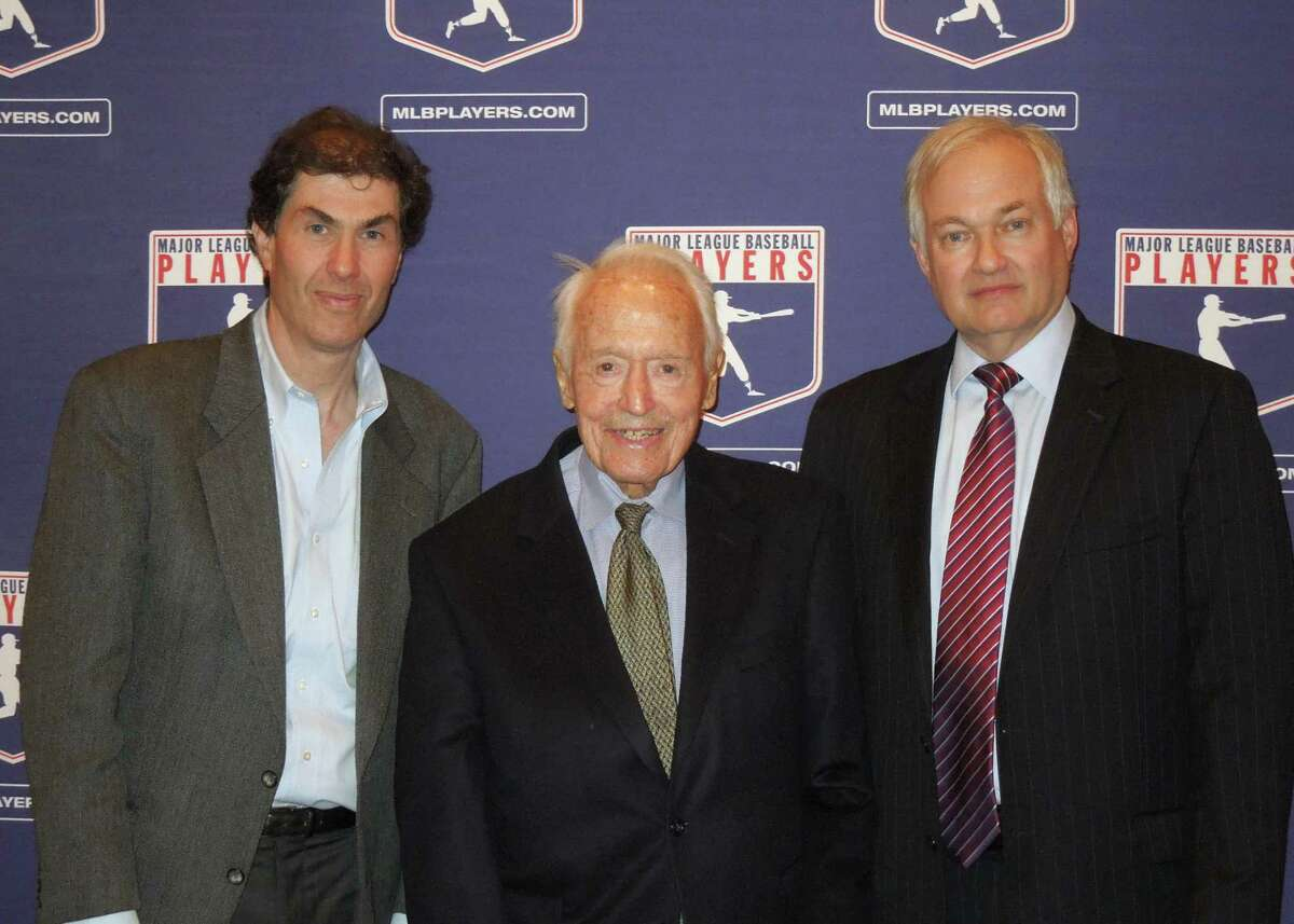 Michael Weiner, left, MLBPA executive director; Marvin Miller, center, former head of the association; and Donald Fehr, former MLBPA executive director and currently the executive director of the NHL Players' Association, gather for a photo at New York University School of Law in New York. By The Associated Press