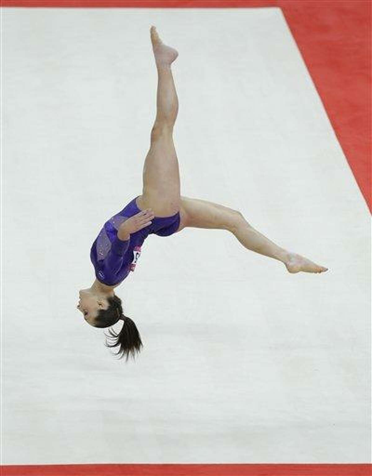 U.S. gymnast Jordyn Wieber performs on the floor during the Artistic Gymnastic women's qualifications at the 2012 Summer Olympics Sunday in London. Associated Press