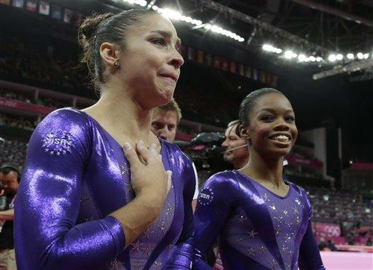 U.S. gymnast Alexandra Raisman, left, reacts after qualifying for the women's all-around final along with teammate Gabrielle Douglas during the Artistic Gymnastics women's qualification at the 2012 Summer Olympics Sunday in London. Associated Press