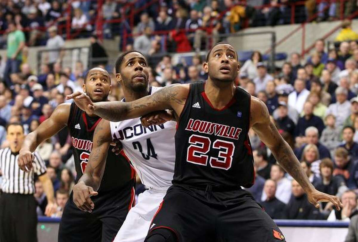 January 29, 2011: Louisville Cardinals forward Terrence Jennings (23), Connecticut Huskies forward/center Alex Oriakhi (34) and Louisville Cardinals guard Preston Knowles (2) battle for position after free throw attempts at Gampel Pavilion in Storrs, Connecticut. Louisville defeated Connecticut in double overtime 79-78. (Cal Sports Media via AP Images)