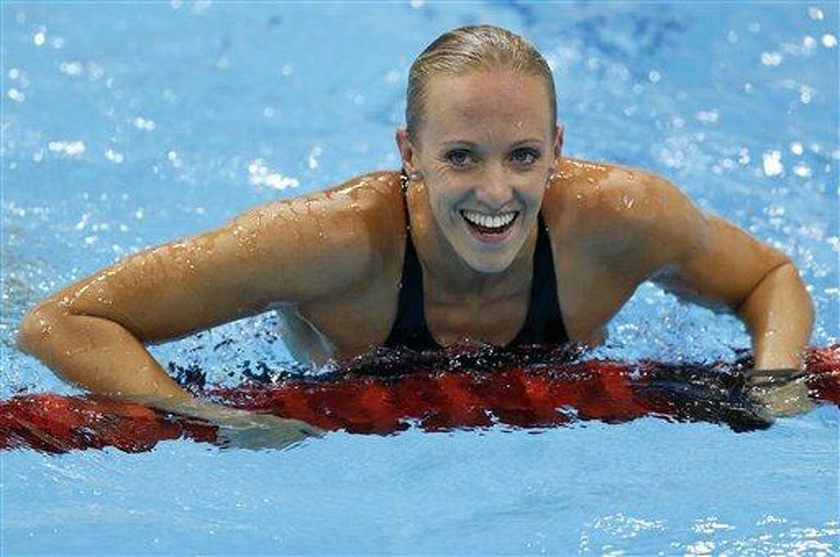 United States' Dana Vollmer reacts to her gold medal win in the he women's 100-meter butterfly swimming final at the Aquatics Centre Sunday in the Olympic Park during the 2012 Summer Olympics in London. Associated Press