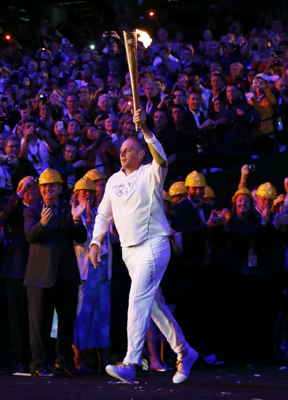 ASSOCIATED PRESS Steve Redgrave enters the Olympic stadium with the Olympic flame during the Opening Ceremony at the 2012 Summer Olympics on Saturday in London.