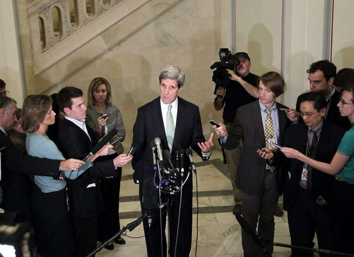 Debt supercommittee member Sen. John Kerry, D-Mass., speaks with reporters as the deficit reduction panel's mandate ends in failure on Capitol Hill in Washington Monday. Associated Press