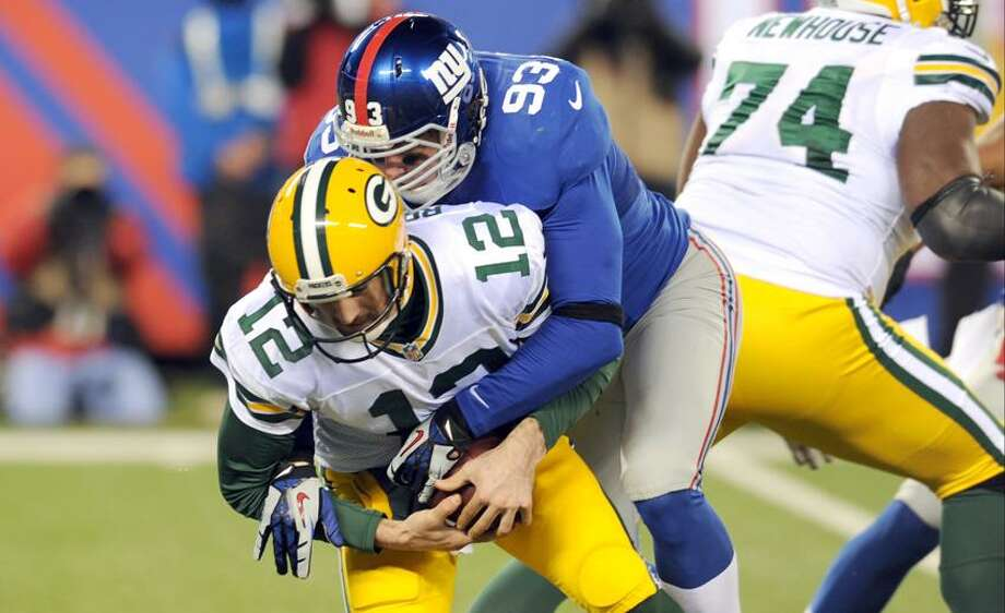 New York Giants middle linebacker Chase Blackburn gets past Green Bay Packers' Marshall Newhouse (74) to sack Aaron Rodgers (12) during the first half of an NFL football game Sunday, Nov. 25, 2012 in East Rutherford, N.J. (AP Photo/Bill Kostroun) Photo: AP / FR51951 AP