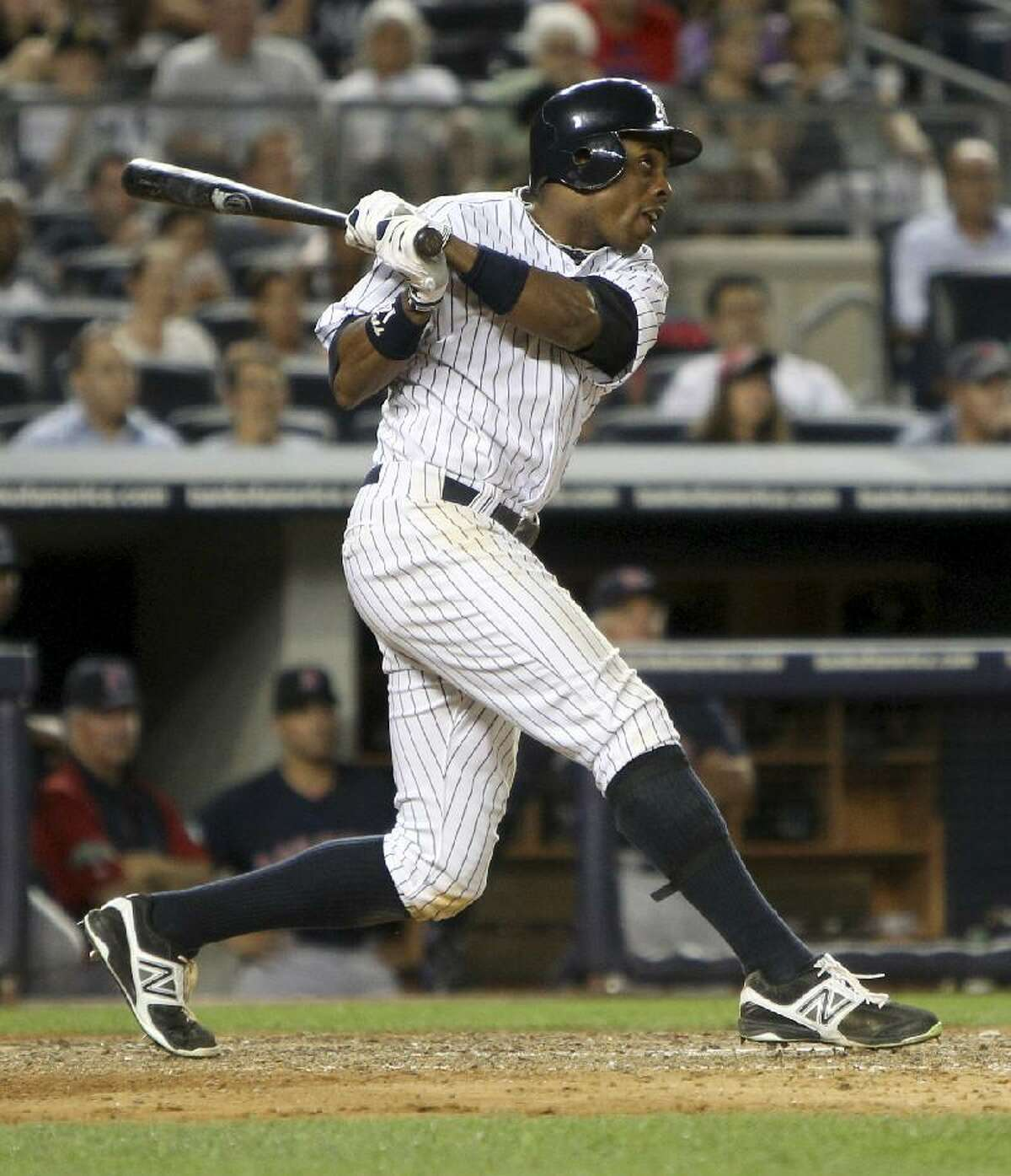 ASSOCIATED PRESS New York Yankees center fielder Curtis Granderson hits a grand slam during the eighth inning of Friday night's game against the Boston Red Sox at Yankee Stadium in New York. The Yankees defeated the Red Sox 10-3.