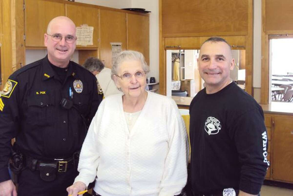 RICKY CAMPBELL/ Register CitizenSgt. Fox and Officer Pietrafesa from Winchester Police stand with Open Door Soup Kitchen president Helen Nay after police helped serve a hot lunch on Tuesday at the kitchen.