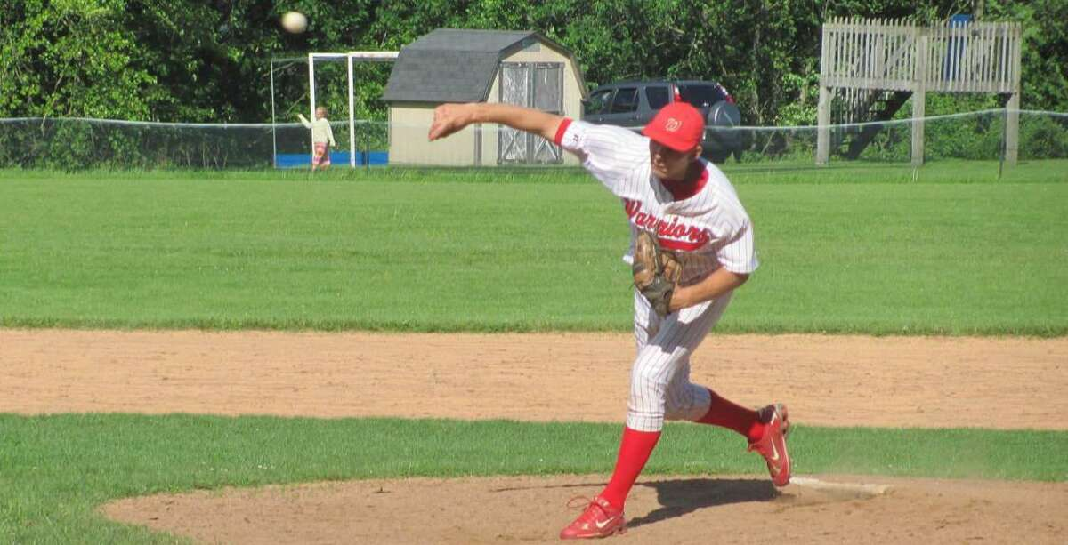 JOHN D. NESTOR/Register Citizen Correspondent Wamogo ace right-hander Mike Odenwaelder delivers a pitch during the Warriors' 7-5 win over Hale-Ray in Litchfield on Thursday.