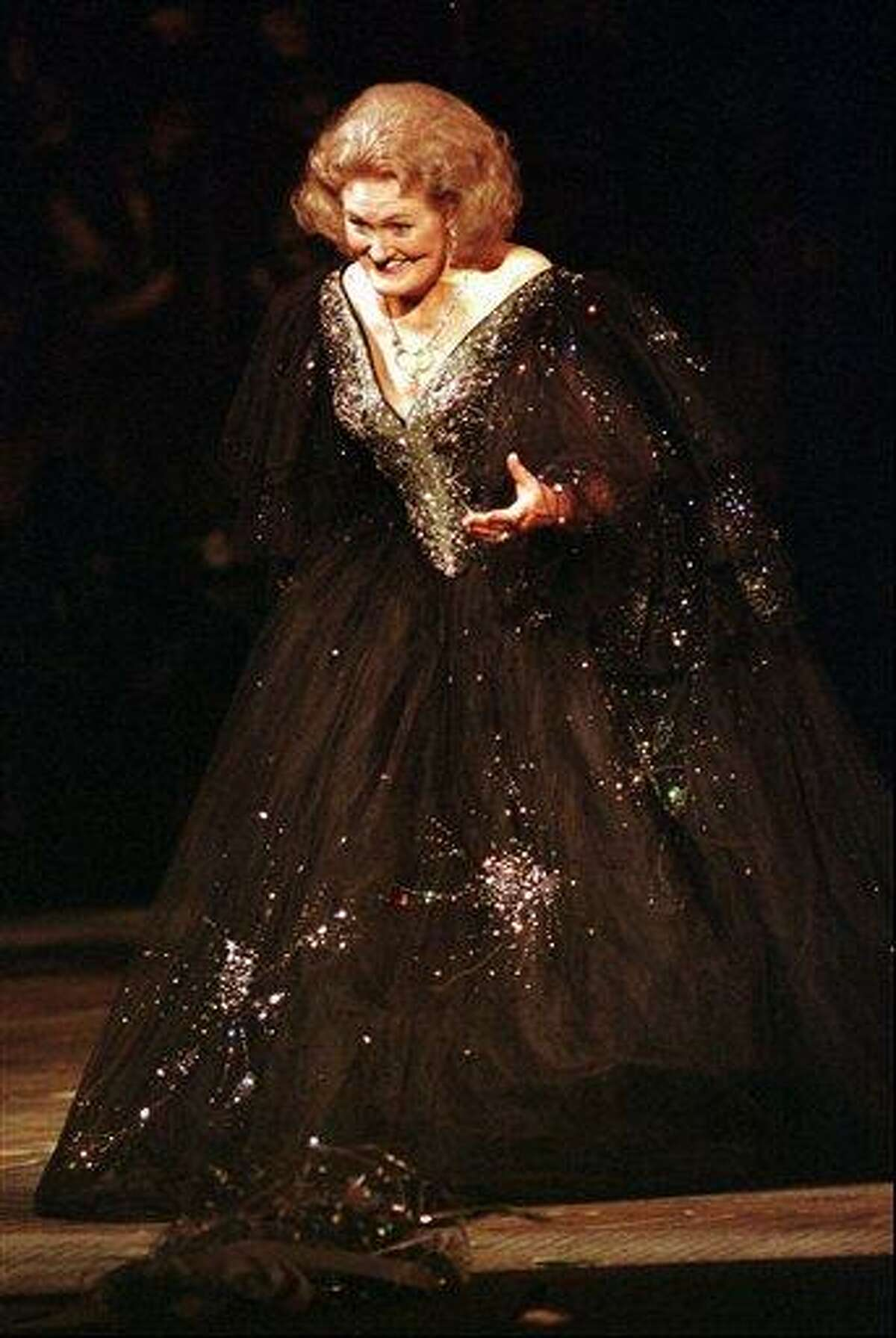 FILE - In this Sept. 5, 1997 file photo, Australian opera soprano Joan Sutherland gestures her appreciation for flowers thrown onto the stage during the Gala Concert in celebration of the reopening of the San Francisco War Memorial Opera House. A memorial service for opera star Joan Sutherland will be held at Westminster Abbey in London on Tuesday, Feb. 15, 2011. (AP)