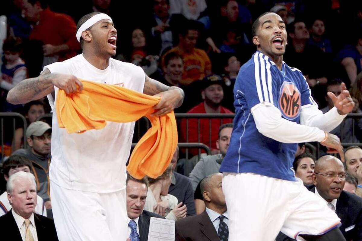 New York Knicks' Carmelo Anthony, left, and J.R. Smith celebrate on the bench during the second half of an NBA basketball game against the Detroit Pistons in New York, Sunday, Nov. 25, 2012. The Knicks won 121-100. (AP Photo/Seth Wenig)