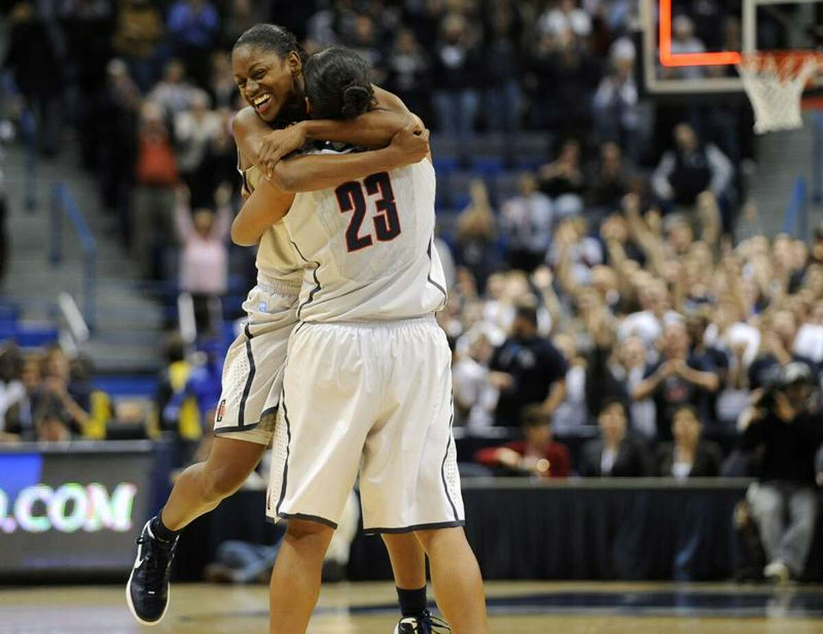 Connecticut's Tiffany Hayes, right, hugs Kaleena Mosqueda-Lewis (23) at the end of an NCAA college basketball game against Stanford in Hartford, Conn., Monday, Nov. 21, 2011. Connecticut won 68-58. (AP Photo/Jessica Hill)