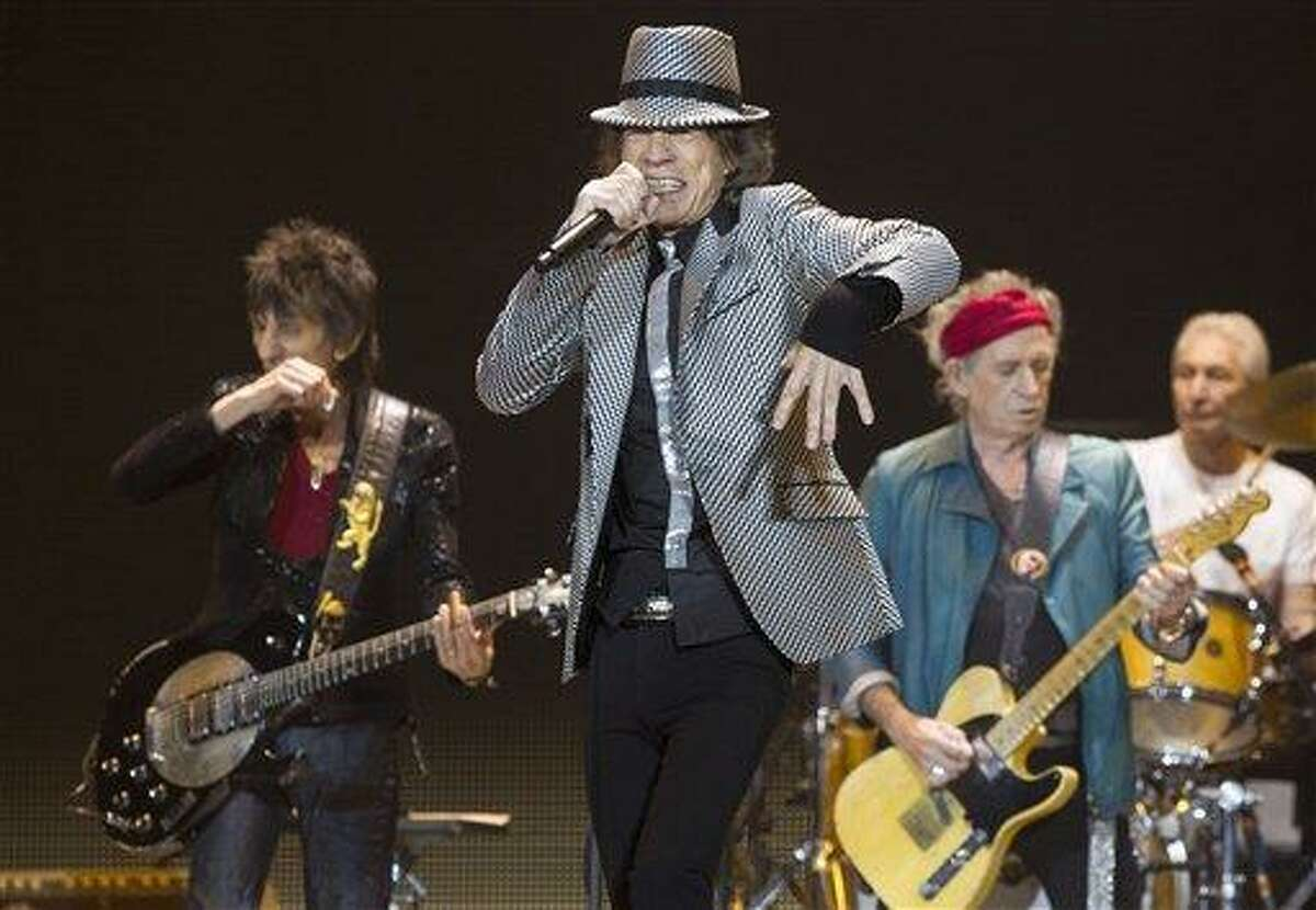 Mick Jagger, center, Keith Richards, Ronnie Wood, left, and Charlie Watts, right, of The Rolling Stones perform at the O2 arena in east London, Sunday. Photo by Joel Ryan/Invision