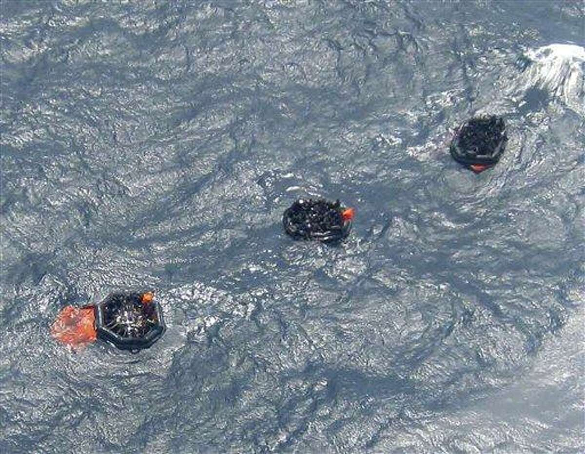 Three life rafts from the MV Rabaul Queen float above the sunken hull of the ferry in the open waters off Papua New Guinea's east coast Thursday. Rescuers plucked more than 200 survivors from the sea off Papua New Guinea's east coast after the ferry sank Thursday with as many as 350 people on board, officials said. Associated Press