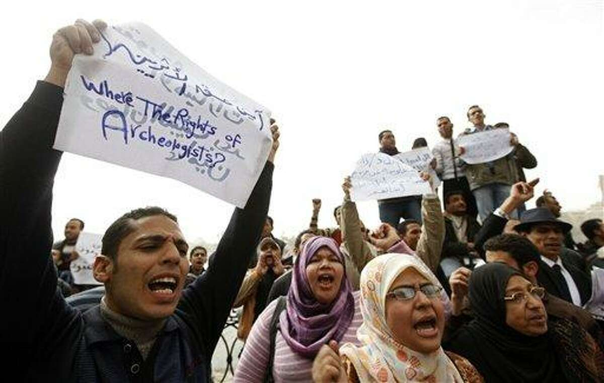 Jobless archeology graduates protest in demand of jobs in the Egyptian museum, in Cairo, Egypt, Wednesday Feb. 16, 2011. Labor unrest unleashed by the ousting of Hosni Mubarak flared again Wednesday in Egypt despite a warning by the ruling military that protests and strikes were hampering efforts to improve the economy and return life to normal.(AP Photo/Hussein Malla)