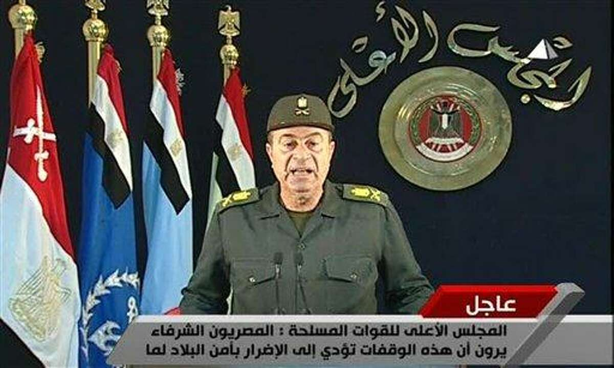 In this image from Egyptian state television Monday Feb 14 2011 an unidentified Egyptian army Major General addresses the nation. Egypt's ruling military council has issued a new communique calling on labor leaders to stop strikes and protests to allow a sense of normalcy to return to the country. The communique came as thousands of state employees, from ambulance drivers to police and transport workers, protested Monday to demand better pay and conditions(AP Photo/ Egyptian TV) EGYPT OUT TV OUT