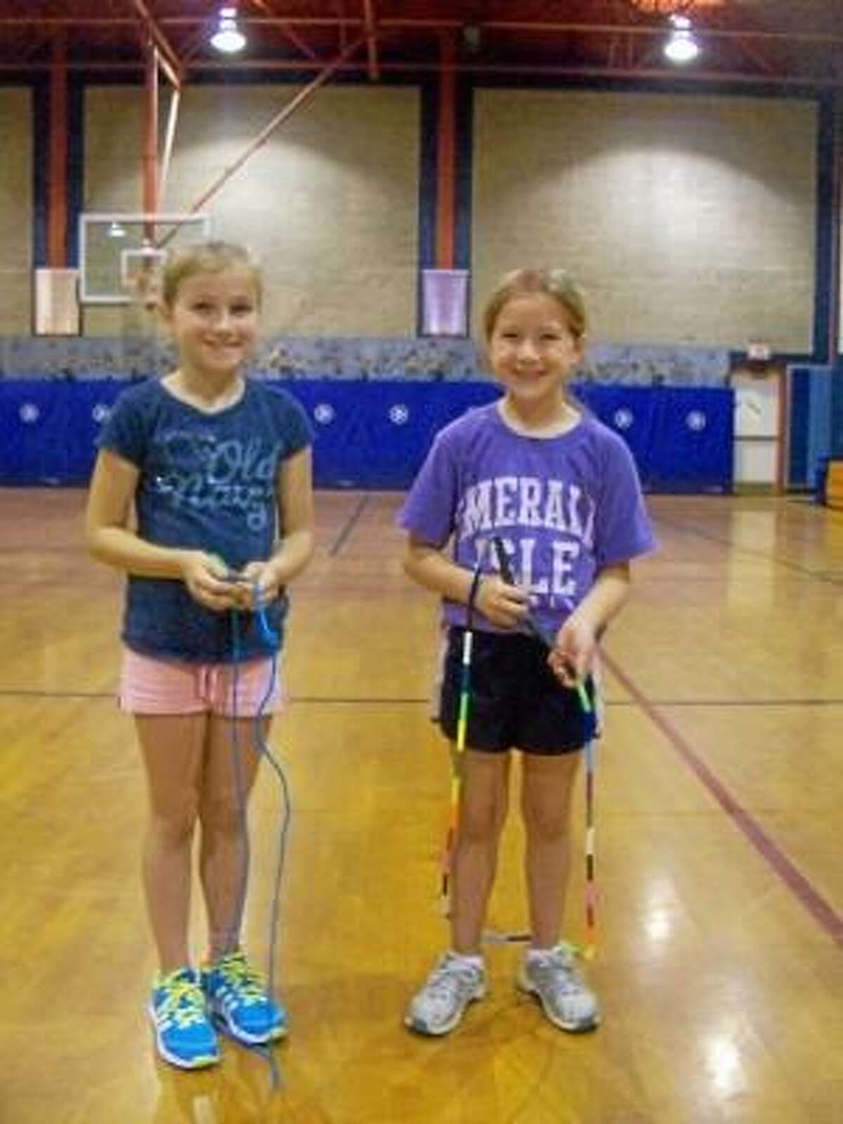 PETER WALLACE/Register Citizen Most Forbes Flyers, like Olivia Gordon and Suzie Navin, both 9 years old, begin their Flyer careers in the third grade.