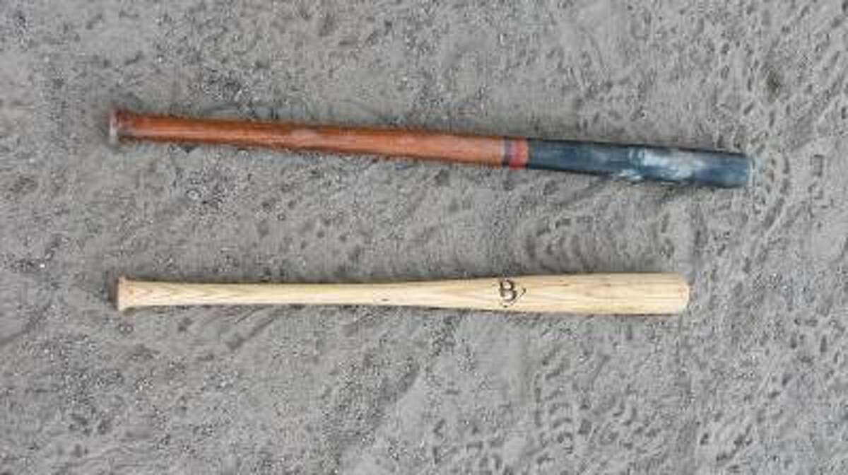 JOHN NESTOR/Register Citizen Correspondent A vintage bat (top) like the ones used Saturday compared to a modern wood bat.