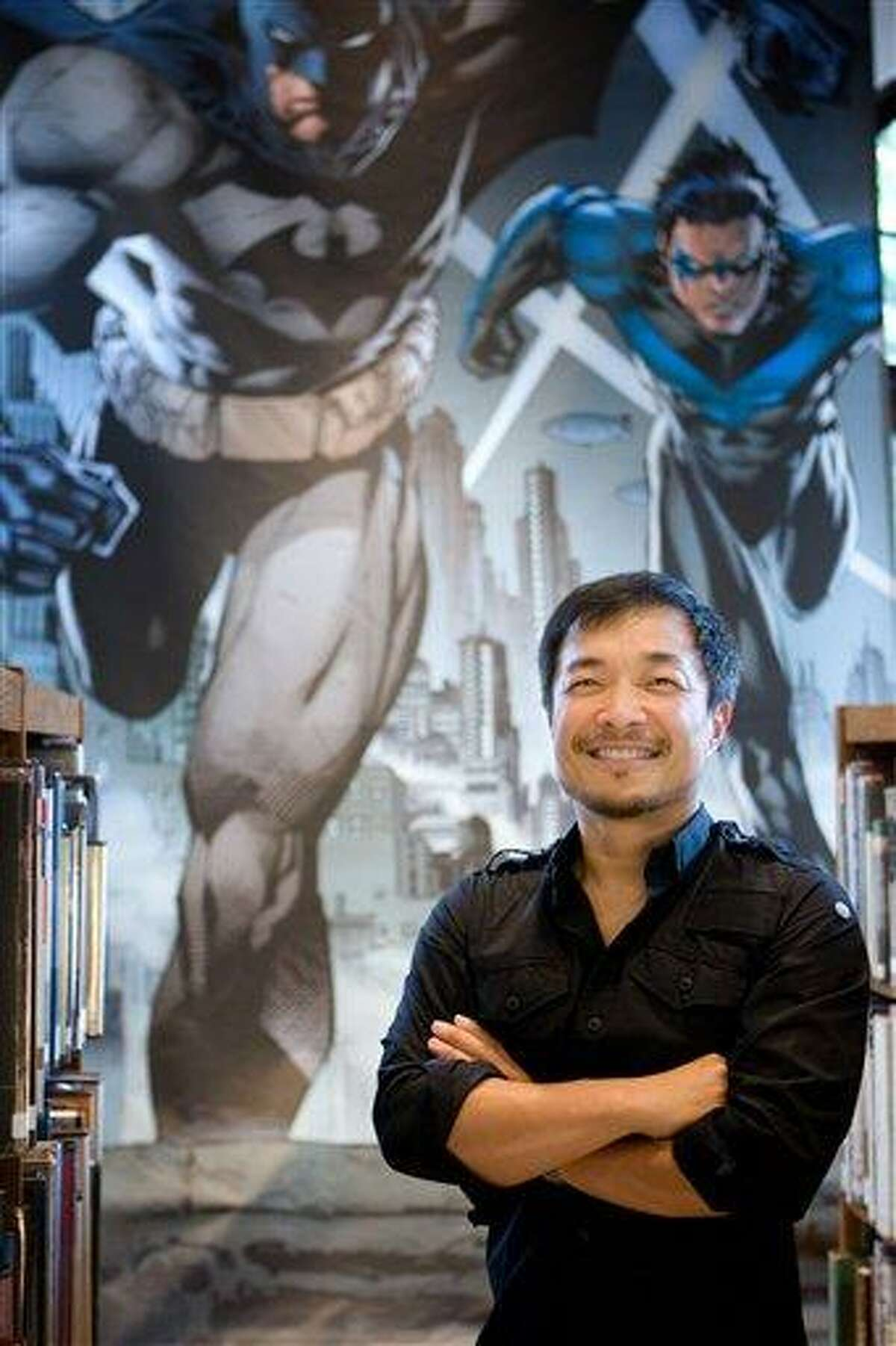 In this publicity mage released by DC Comics, DC Comics' co-publisher Jim Lee is shown. DC Comics is going back to the starting point in September, renumbering its entire lineup of DC Universe titles with No. 1 and retooling nearly all of its major characters, including Superman, Wonder Woman and Batman.(AP Photo/DC Comics, Victor Ha)