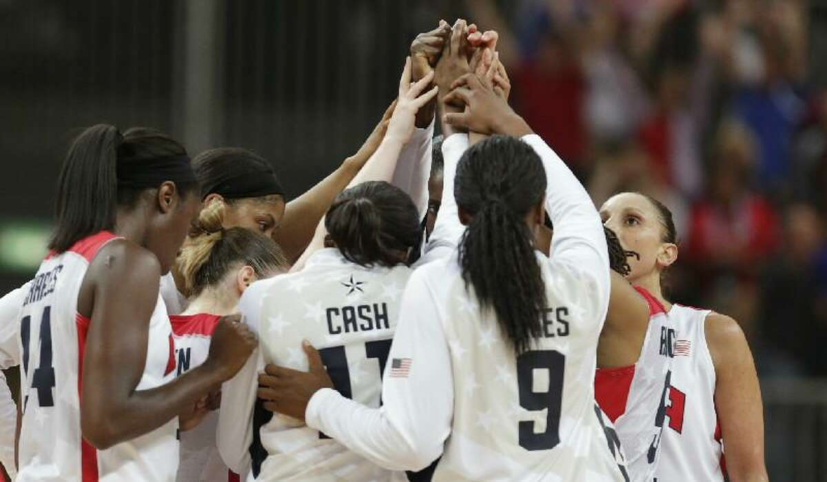 ASSOCIATED PRESS The United States women's team joins hands after beating Croatia in a basketball game at the 2012 Summer Olympics Saturday in London.